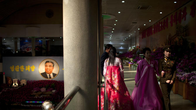 People visit a flower show featuring thousands of Kimilsungia flowers, named after the late leader Kim Il Sung, in Pyongyang, North Korea, Friday, April 12, 2013. (AP Photo/Alexander F. Yuan)