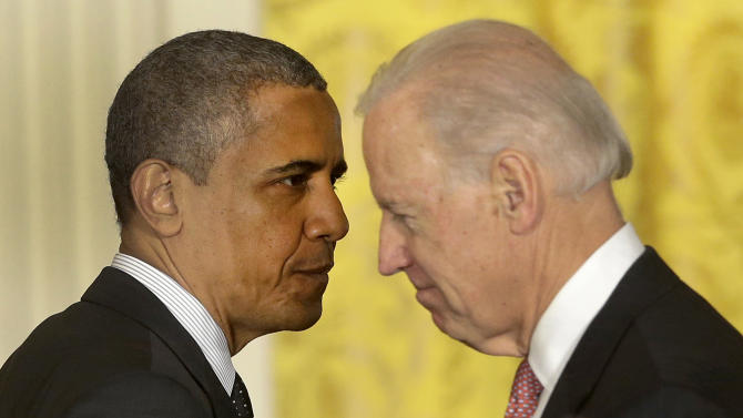 President Barack Obama passes Vice President Joe Biden after speaking on the economy and the deficit, Friday, Nov. 9, 2012, in the East Room of the White House in Washington. (AP Photo/Pablo Martinez Monsivais)