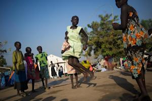 Girls skip a rope at a camp for internally displaced …