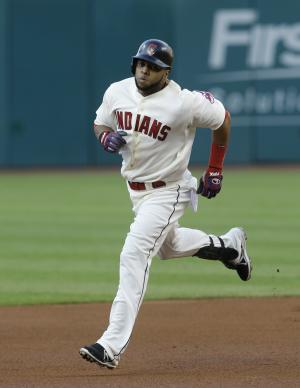 Cleveland Indians' Carlos Santana runs the bases after hitting a two-run home run off Minnesota Twins starting pitcher Liam Hendriks in the first inning of a baseball game on Saturday, Aug. 24, 2013, in Cleveland. Jason Kipnis also scored. (AP Photo/Tony Dejak)