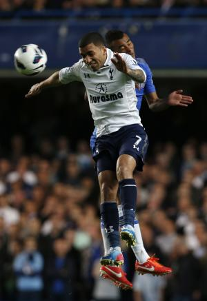 Chelsea's Ashley Cole, right, competes with Tottenham Hotspur's Aaron Lennon during their English Premier League soccer match at Stamford Bridge, London, Wednesday, May 8, 2013. (AP Photo/Sang Tan)