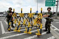 "South Korean soldiers install a barricade on a highway during a civil defence drill as part of a joint US-South Korean exercise called Ulchi Freedom Guardian in 2011. North Korea Monday hit out at the United States and South Korea over their planned joint military drill this month which it said was ""an all-out war rehearsal"" that could ignite conflict on the Korean Peninsula"