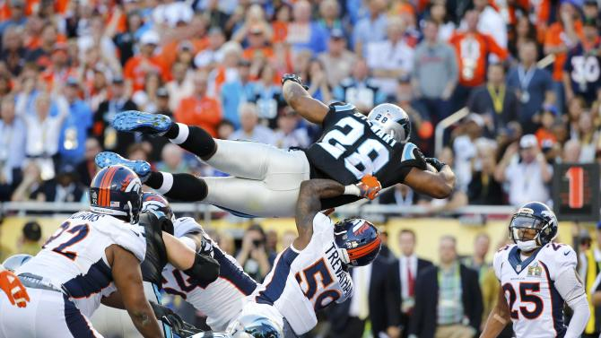 Carolina Panthers' Stewart dives for a touchdown during the second quarter as Denver Broncos' Harris Jr. looks on during the NFL's Super Bowl 50 football game in Santa Clara