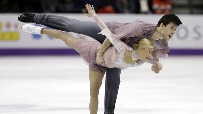 Tatiana Volosozhar and Maxim Trankov, of Russia, perform during the pairs free skate program at the World Figure Skating Championships Friday, March 15, 2013, in London, Ontario. (AP Photo/Darron Cummings)