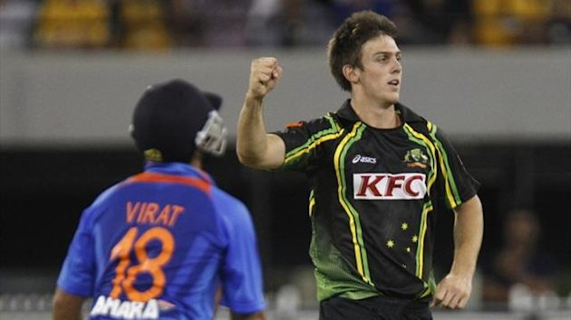 Mitchell Marsh of Australia celebrates taking the wicket of Virat Kohli of India during their T20 International series cricket match at the Melbourne Cricket Ground in 2012 (Reuters)