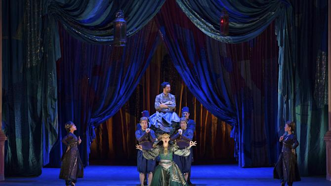 """In this March 25, 2013 photo provided by the Metropolitan Opera, Natalie Dessay as Cleopatra, bottom, and Christophe Dumaux as Tolomeo, top, perform during a rehearsal of Handel's """"Giulio Cesare."""" (AP Photo/ Metropolitan Opera, Marty Sohl)"""