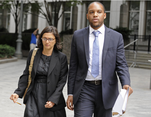 Federal defense attorneys Sabrina Shroff and Jerrod Thompson Hicks exit Manhattan federal court, Saturday, Oct. 6, 2012, in New York. Abu Hamza al-Masri, entered no plea to charges of conspiring with