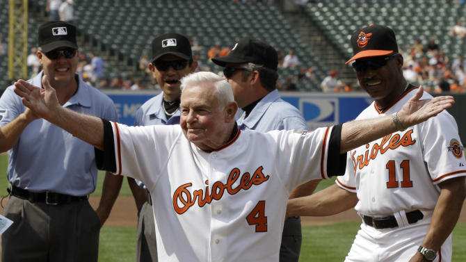 FILE - In this Saturday, June 26, 2010 file photo, former Baltimore Orioles manager Earl Weaver (4) waves to the crowd after taking the lineup card out before the start of a baseball game between the Orioles and Washington Nationals, in Baltimore, as members of the Orioles' 1970 team were honored before the start of the game. At right is interim manager Juan Samuel (11). Weaver, the fiery Hall of Fame manager who won 1,480 games with the Baltimore Orioles, has died, the team announced Saturday, Jan. 19, 2013. He was 82. (AP Photo/Rob Carr, File)