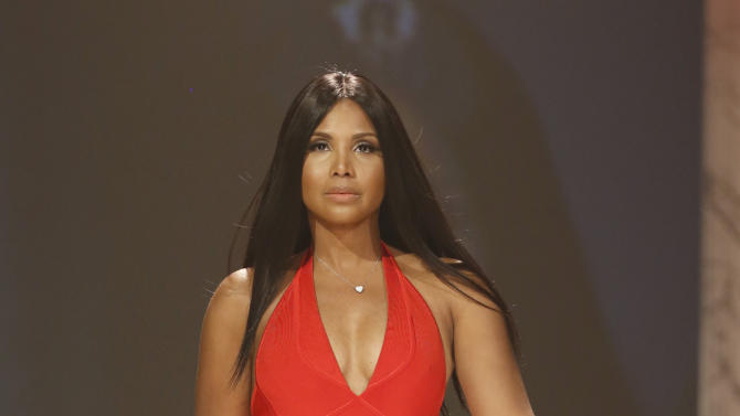Toni Braxton walks the runway at the Red Dress Collection 2013 Fashion Show, on Wednesday, Feb. 6, 2013 in New York. (Photo by John Minchillo/Invision/AP)