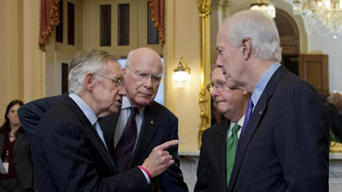 In this Feb. 12, 2014, photo, Senate Majority Leader Harry Reid, D-Nev., from left, Sen. Patrick Leahy, D-Vt., Republican Leader Mitch McConnell, R-Ky., and Sen. John Cornyn, R-Texas, talk as they wait in the majority leader's office, for a meting King Abdullah II of Jordan, on Capitol Hill in Washington. The meeting came after lawmakers voted on must-pass legislation to increase the government's debt limit and after their leaders decided to drop the parliamentary equivalent of a curtain on the voting until its outcome was assured (AP Photo/Manuel Balce Ceneta)