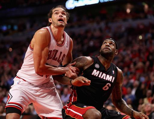 James, Bosh lead Heat past Bulls, 104-94