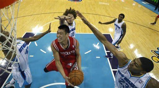 Carlos Delfino helps Rockets beat Hornets, 97-90