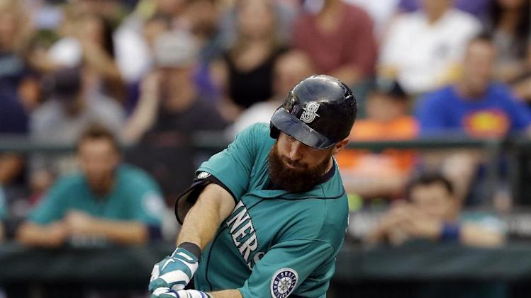 Seattle Mariners' Dustin Ackley triples against the Washington Nationals in the second inning of a baseball game Friday, Aug. 29, 2014, in Seattle. (AP Photo/Elaine Thompson)