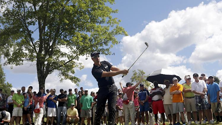 Henrik Stenson, of Sweden, hits out of the woods on the first hole during the final round of play in the Tour Championship golf tournament at East Lake Golf Club, in Atlanta, Sunday, Sept. 22, 2013. (AP Photo/John Bazemore)