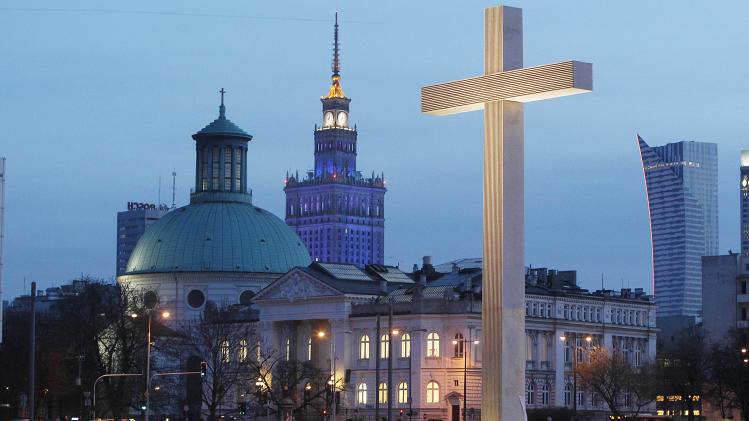 FILE - In this April 2, 20014 file photo an unusually empty main square with a commemorative cross in downtown Warsaw, Poland on Wednesday, April 2, 20014 during observances marking nine years since the death of much-loved Polish-born Pope John Paul II. Over the years, the observances attract fewer and fewer people in an a sign that the enthusiasm that the Poles accord one of their greatest countrymen is gradually dissipating.(AP Photo/Czarek Sokolowski, File)