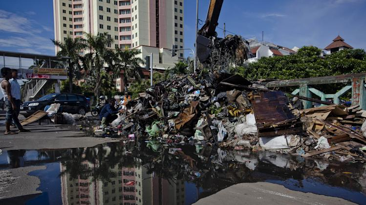 Clean Up Underway As Jakarta Prepares For More Rain