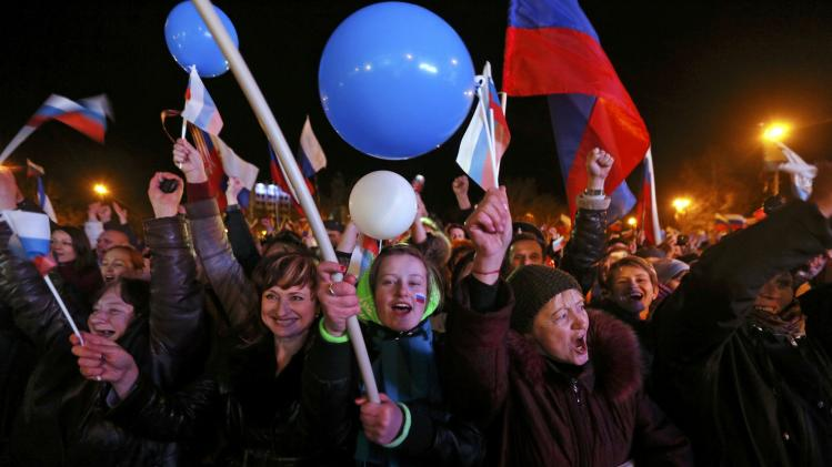 People celebrate as they wait for the announcement of preliminary results of today's referendum in Sevastopol