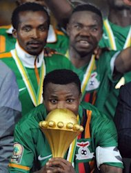 Zambia's captain Christopher Katongo kisses the trophy during the award ceremony following their African Cup of Nations final match against Ivaory Coast, at the stade de l'Amitie in Libreville, on February 11, 2012. Zambia and Egyptian club Al-Ahly defied the odds this year to lift the most prized silverware in the African football trophy cabinet