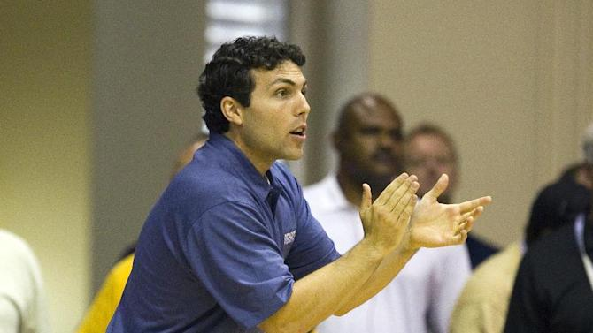 Memphis head coach Josh Pastner encourages his team in the first half of an NCAA college basketball game Monday, Nov. 21, 2011, in Lahaina, Hawaii.  (AP Photo/Eugene Tanner)