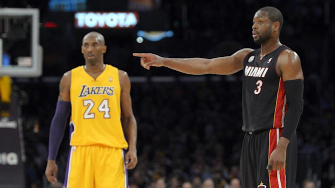 Miami Heat guard Dwyane Wade (3) points as Los Angeles Lakers guard Kobe Bryant (24) stands by during the first half of their NBA basketball game, Thursday, Jan. 17, 2013, in Los Angeles. (AP Photo/Mark J. Terrill)