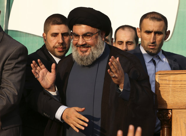 In this Monday, Sept. 17, 2012 photo, Hezbollah leader Sheik Hassan Nasrallah, center, waves to his supporters, in the southern suburb of Beirut, Lebanon. The leader of the Lebanese militant Hezbollah group has claimed responsibility for launching the drone aircraft that entered Israeli airspace earlier this week. The rare admission Thursday by Hassan Nasrallah raises regional tensions at a sensitive time when the group&#39;s backers, Syria and Iran, are under pressure. (AP Photo/Hussein Malla)