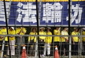 Falun Gong members take part in a protest as Zhang Zhijun, director of China's Taiwan Affairs Office, visits the labour activity centre in New Taipei City
