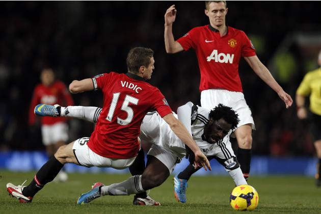 Manchester United's Vidic and Fletcher challenge Swansea City's Bony during their English Premier League soccer match in Manchester