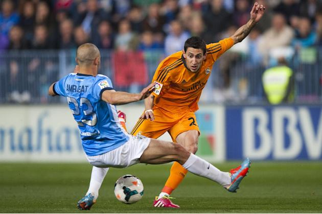 Real Madrid's Angel Di Maria from Argentina, right, in action with CF Malaga's Nordin Amrabat, from Morocco during a Spanish La Liga soccer match at La Rosaleda stadium in Malaga, Spain, Satur