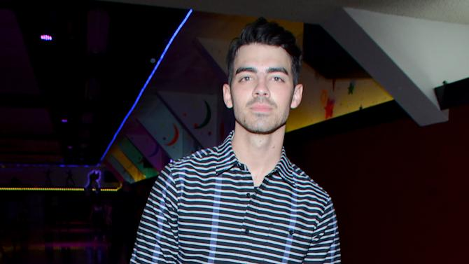 EXCLUSIVE - Joe Jonas attends Just Jared's Throwback Thursday Party Presented by Monster High at Moonlight Rollerway on Thursday, March 26, 2015, in Glendale, Calif. (Photo by Tonya Wise/Invision for Just Jared!/AP Images)