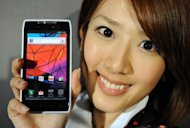 A model from Motorola Mobility Japan shows off the company&#39;s new smartphone, &#39;Motorola Razr&#39; in March 2012. Google intends to allow its newly acquired Motorola Mobility to keep its autonomy as it battles in the hotly contested smartphone market, executives said Thursday