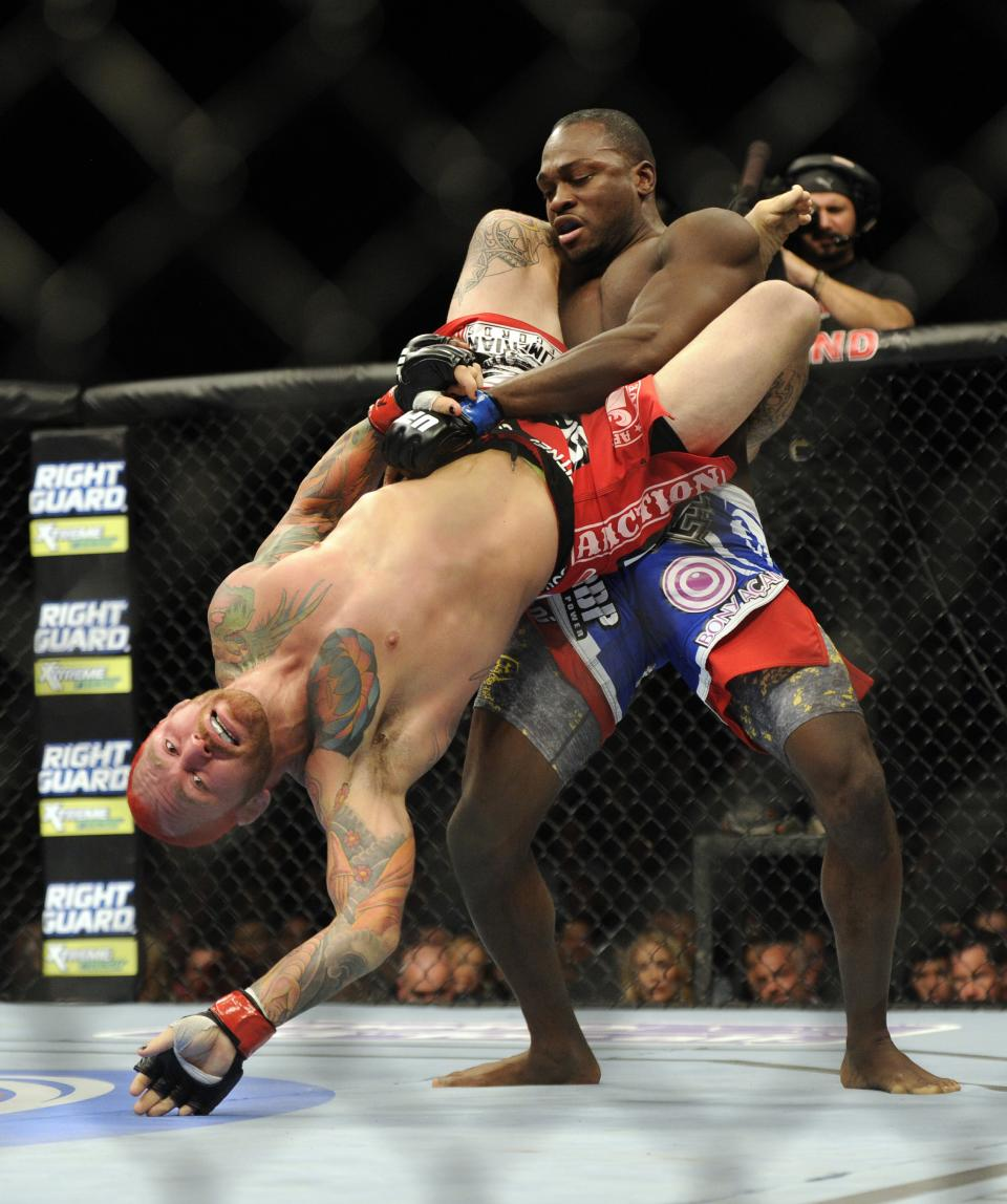 Derik Brunson of Wilmington, N.C. hold Chris Leben of Hawaii over the mat during their UFC 155 middleweight mixed martial arts match at the MGM Grand Garden Arena Saturday, Dec, 29, 2012 in Las  Vegas. Bunson won the bout by an unanimous decision.  (AP Photo/David Becker)