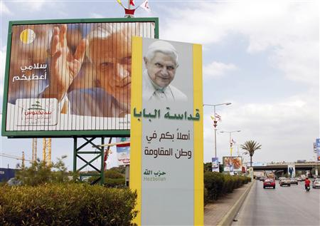 Billboards and a banner erected by Hezbollah depicting Pope Benedict XVI are seen installed at the main airport road in Beirut