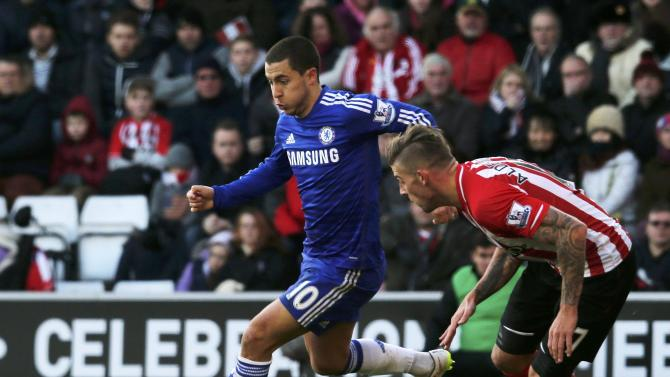 Eden Hazard of Chelsea surges past Toby Alderweireld of Southampton as he closes in on goal to score during their English Premier League soccer match at St Mary's Stadium in Southampton, southern England