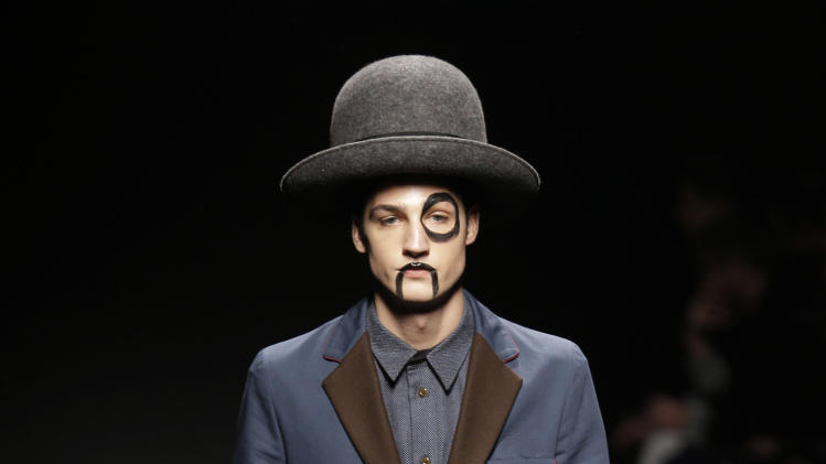 A model wears a creation for Vivienne Westwood men's Fall-Winter 2013-14 collection, part of the Milan Fashion Week, unveiled in Milan, Italy, Sunday, Jan. 13, 2013. (AP Photo/Luca Bruno)