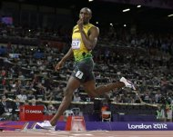 Jamaica&#39;s Usain Bolt gestures as he crosses the finish line to win gold in the men&#39;s 200-meter final during the athletics in the Olympic Stadium at the 2012 Summer Olympics, London, Thursday, Aug. 9, 2012. (AP Photo/David J. Phillip)