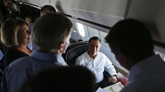 FILE - In this Oct. 1, 2012, file photo Republican presidential candidate Mitt Romney talks with senior advisers on his campaign plane en route to Denver. If he becomes president, Romney may well face difficulties in foreign policy; he irritated Britons and Palestinians during a summer tour abroad and has declared Russia to be America's No. 1 geopolitical foe. And just last week the Republican presidential candidate, who plans a foreign policy speech Monday Oct. 8, 2012, raised eyebrows in Spain by holding it up as a prime example of government spending run amok. At left is senior adviser Beth Myers. (AP Photo/Charles Dharapak, File)