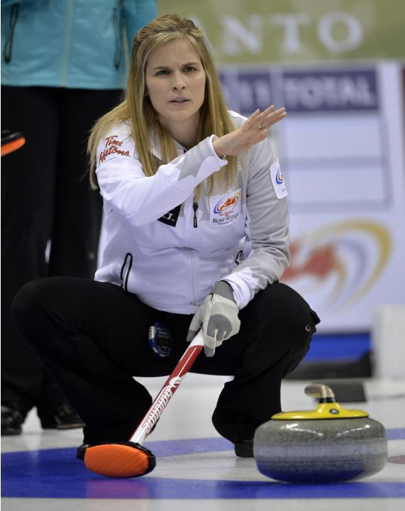 Skip Jones signals to sweepers against Team Homan during the Roar of the Rings Canadian Olympic Curling Trials in Winnipeg