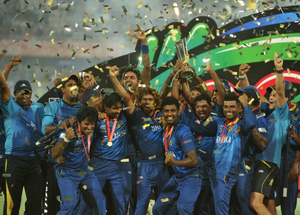 with the trophy after winning the ICC Twenty20 World Cup cricket ...