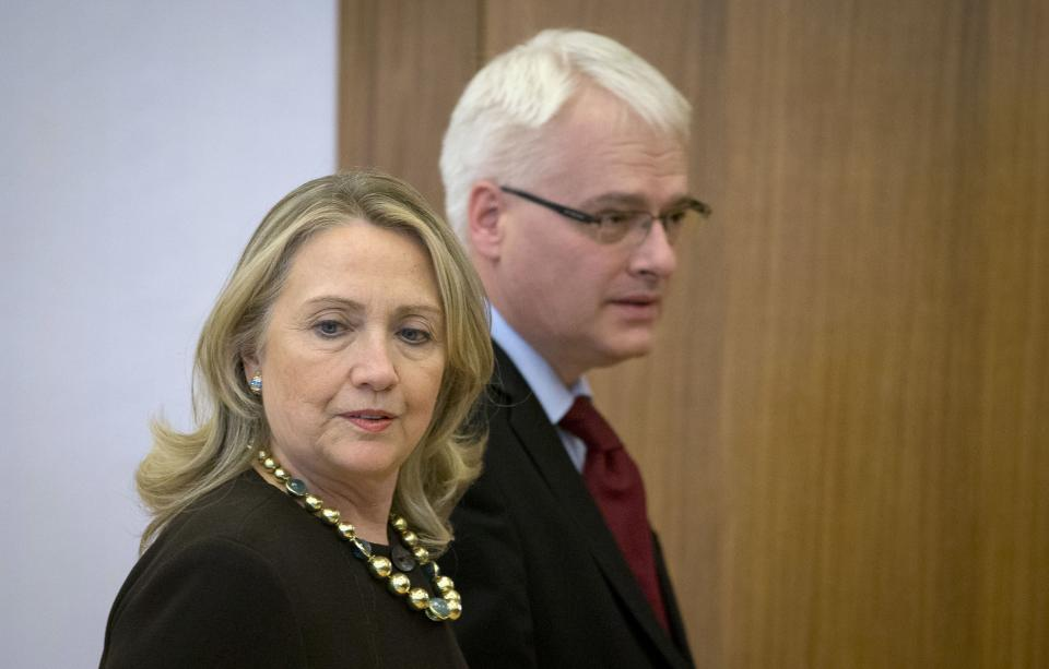US Secretary of State Hillary Rodham Clinton, left, and Croatia's President Ivo Josipovic walk at the president's office, in Zagreb, Croatia, Wednesday, Oct. 31, 2012. Clinton is currently touring northern Africa and southeast Europe. (AP Photo/Darko Bandic)