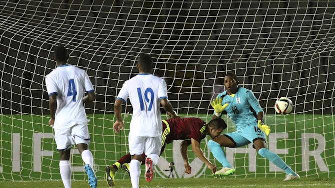 Venezuela's Tomas Rincon heads the ball in front of Honduras' goalie Luis Lopez during their friendly soccer match at Cachamay stadium in Puerto Ordaz