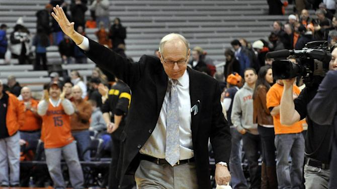 Syracuse head coach Jim Boeheim acknowledges the fans after his team defeated Rutgers 78-53 for his 903rd career victory passing Bobby Knight in an NCAA college basketball game in Syracuse, N.Y., Wednesday, Jan. 2, 2013. (AP Photo/Kevin Rivoli)