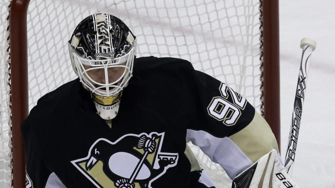 Pittsburgh Penguins goalie Tomas Vokoun (92) stops a shot by New York Islanders' Michael Grabner (40) during the first period of Game 5 of an NHL hockey Stanley Cup first-round playoff series, Thursday, May 9, 2013, in Pittsburgh. (AP Photo/Gene J. Puskar)