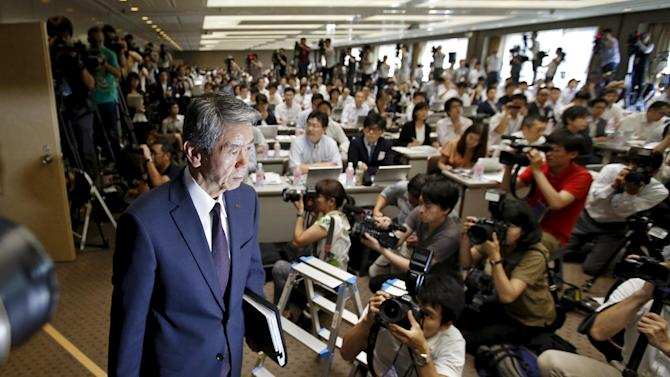 File photo of Toshiba Corp President and Chief Executive Officer Hisao Tanaka arriving for a news conference at the company headquarters in Tokyo