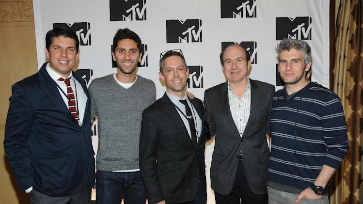 "From left, Diego Fernandez from Burger King, Nev Schulman from ""Catfish: The TV Show"", David Jablonowski from  Starcom, Philippe Dauman President and CEO Viacom, Max Joseph from ""Catfish: The TV Show"" arriving at the 2013 MTV Upfront, on Thursday, April 25, 2013 at the Beacon Theater in New York. (Photo by Scott Gries/Invision/AP Images)"
