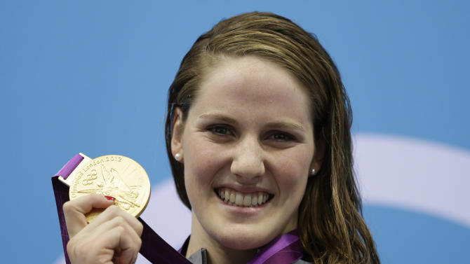 United States' Missy Franklin poses with her gold medal for the women's 100-meter backstroke swimming final at the Aquatics Centre in the Olympic Park during the 2012 Summer Olympics in London, Monday, July 30, 2012. (AP Photo/Michael Sohn)