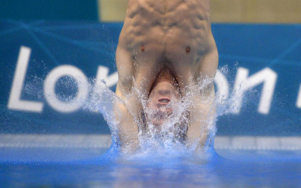 David Boudia of the United States dives during the men's 10-meter platform diving final at the Aquatics Centre in the Olympic Park during the 2012 Summer Olympics in London, Saturday, Aug. 11, 2012. Boudia won the gold medal in the event. (AP Photo/Mark J. Terrill)