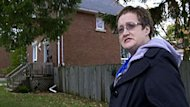 Mary Ann Russwurm stands outside the Hanover, Ont., house she shared with her daughter, Christine Harron, before the teenager disappeared in 1993.