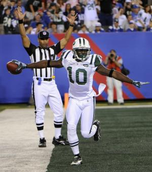 New York Jets' Santonio Holmes celebrates his touchdown during the second quarter of an NFL preseason football game against the New York Giants, Monday, Aug. 29, 2011, in East Rutherford, N.J. (AP Photo/Bill Kostroun)
