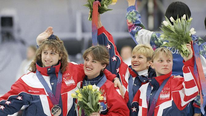 FILE - In this Feb. 22, 1994 file photo, American short track speedskating bronze medalists Nikki Ziegelmeyer, left, Karen Cashman, second from left, Cathy Turner and Amy Peterson, right, celebrate on the podium after receiving their medals for the 3,000-meter relay in Hamar, Norway. A second former U.S. speedskater has made sexual abuse accusations against Olympic medalist and former U.S. Speedskating President Andy Gabel, saying he raped her when she was 15. Nikki Meyer spoke Friday, March 8, 2013, in an interview with The Associated Press. She was known as Nikki Ziegelmeyer when she skated short track for the U.S. in the 1992 and 1994 Olympics. (AP Photo/Doug Mills, File)