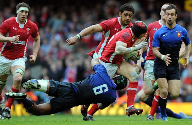 Wales full back Leigh Halfpenny (3R) is tackled by France's captain Thierry Dusautoir during the 6 Nations International rugby union match between Wales and France at the Millenium stadium in Cardiff,